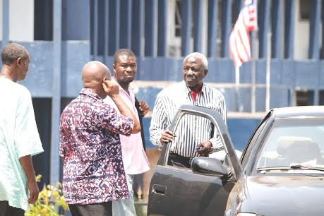 Surveyor Kamara (holding the car door) sold land that does not belong to him photo: Peter Toby