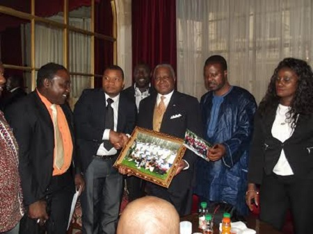 Amb. Thomas (middle) with some members of the Liberian community in France