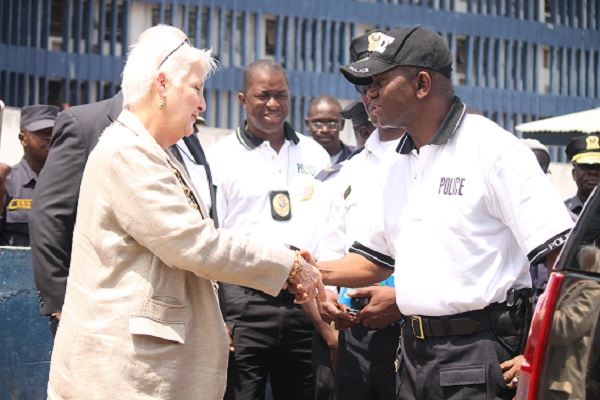 Ambassador Malac shakes hands with Police Director Massaquoi