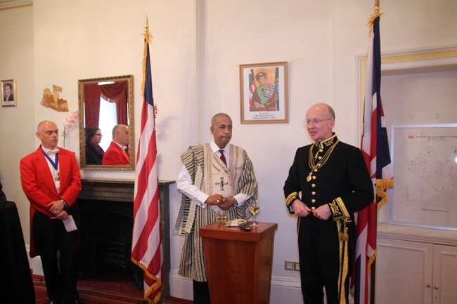 Mr. Harrison speaks at the reception as Ambassador von Ballmoos looks on