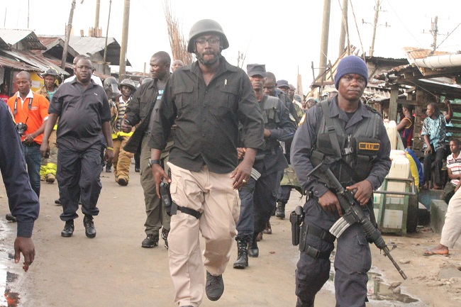 Liberian police officers patrol West Point