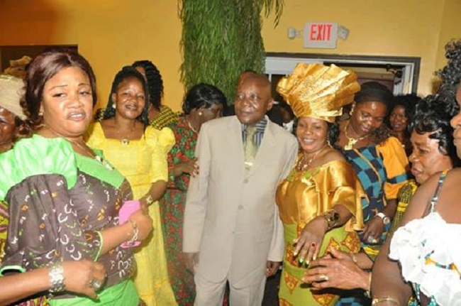Mr. Dennis and a group of supporters at a fundrasing event