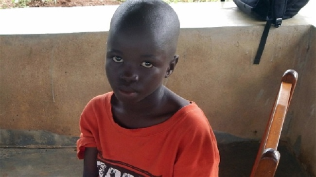 Lamin Borbor, 8, will live at the Interim Care Center for Ebola orphans in Kailahun town until social workers can reunite him with extended family or place him in foster care.  Photo John Sahr/IRIN