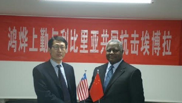 Mr Ren and Ambassador Thomas shake hands after the donation