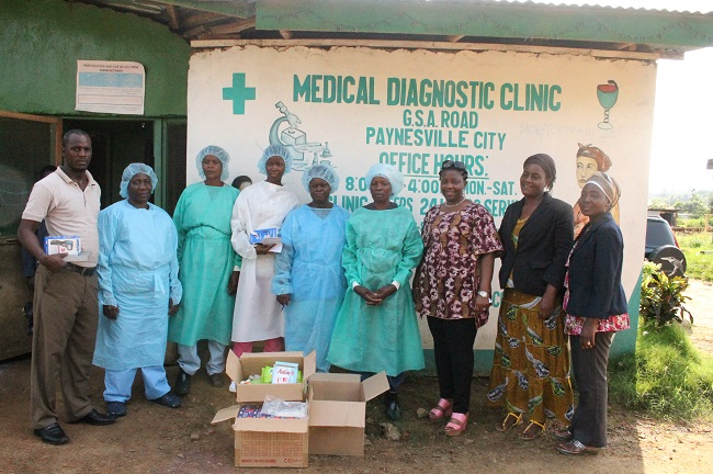 Some of the medical aid given to a clinic outside the Liberian capital. The foundation's executive director W. Piso Saydee Tarr is 3rd from right