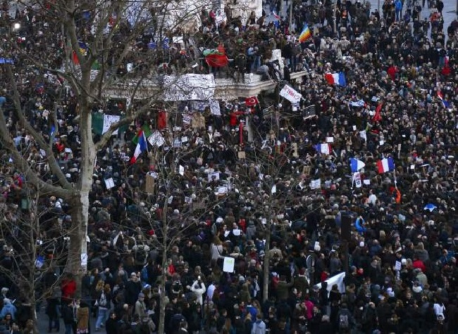 People take part on the Place de la Republique (Republic Square) in Paris in a Unity rally Marche Republicaine on January 11, 2015 in tribute to the 17 victims of a three-day killing spree by homegrown Islamists. The killings began on January 7 with an assault on the Charlie Hebdo satirical magazine in Paris that saw two brothers massacre 12 people including some of the country's best-known cartoonists, the killing of a policewoman and the storming of a Jewish supermarket on the eastern fringes of the capital which killed 4 local residents.       AFP PHOTO / BERTRAND GUAYBERTRAND GUAY/AFP/Getty Images