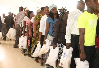 RCCG members with bags of rice donated by Pastor Adeboye