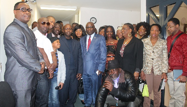 A group of Liberians poses with Ambassador Nyenabo and Director Davis