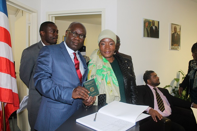Ambassador Nyenabo presents first passport to Ms. Dunbar