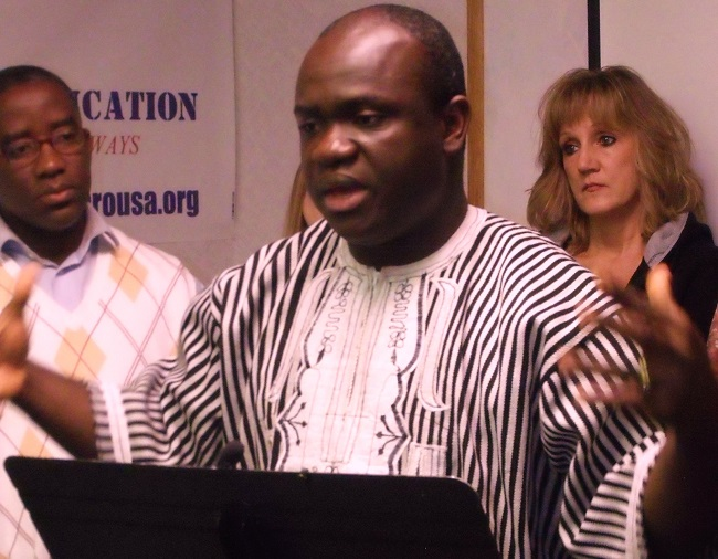 Rev. Collins speaks during the news conference.