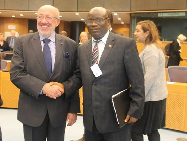 Amb. Nyenabo (right) in handshake with the ACP-EU Parliament Co-President Louis Michel