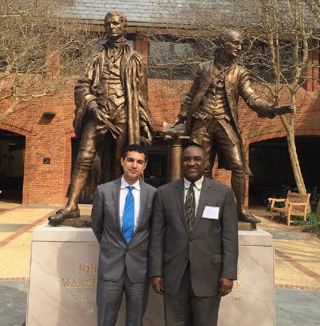 Dr. Khosnood and Mr. Slewion  in front of the William and Mary Law School