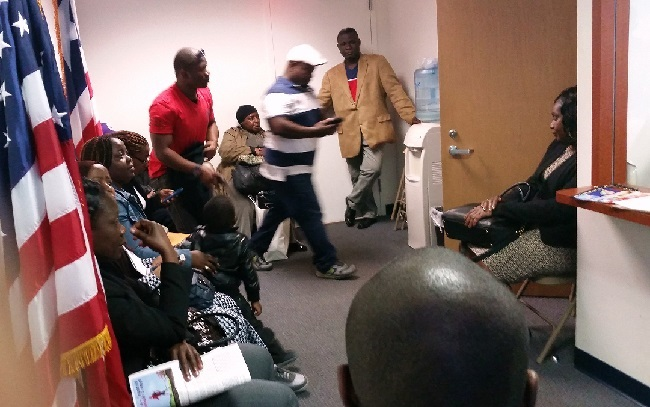 Liberians waiting to process traveled documents recently at the embassy in New York