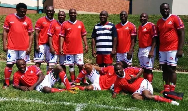 Anthony 'Teacher'Gray (dark blue and white top)  poses with Omega FC at last year's tournament