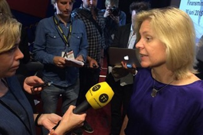 Finance Minister Andersson (right) talks to journalists about the economy