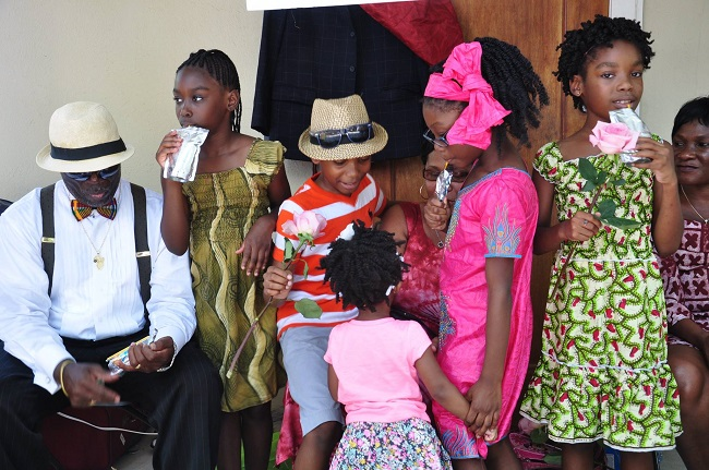 Above are members of the Dehkontee Artists Theatre Children's Peace Theatre engaging in a family friendly interaction after their performance during the cultural extravaganza. The peace process should be inclusive by engaging children in promoting peace and reconciliation because they are the most victimized during civil unrests. This may also provide them self-expression skills as well as develop their innate talents to become eloquent public speakers and ambassadors of peace. Members of the DATI Children's Peace Theatre receive acting lessons, as well as training in improving their literacy skills: writing, reading, speaking, listening, and problem-solving and peaceful conflict resolution skills