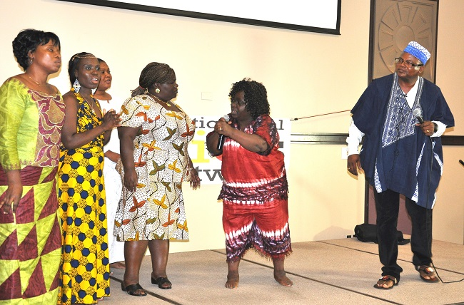 """Some members of the Minnesota LNCA Chapter in a live performance last Saturday during a barbeque health and wellness program hosted in Brooklyn Park, MN, by The Africa Paper and the George Family Foundation's Catalyst Initiative. Far right, Fasuekoi listens carefully as comedian Isabella Wreh-Fofana (middle) relays health messages to the """"townspeople."""" Photo credit: Issa Mansaray/The Africa Paper"""