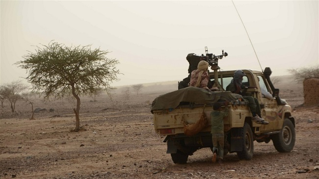 Fighters from the National Movement for the Liberation of Azawad (MNLA) patrol Djebok, an area some 50 kilometre's east of Mali's northern region of Gao, which they seized following fighting with government forces in May 2014. Photo: Katarina Höije/IRIN