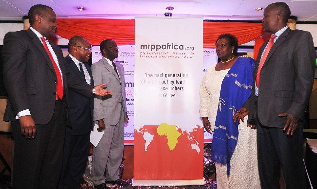 MRPP unveiling L-R Mr Henry Rotich, Prof Tade Aina, Dr Willy Mutunga, Prof Judith Bahemuka and Hon Julius Melly