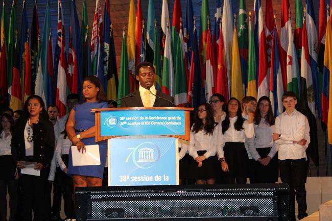 Liberian Elton James Bon reads the Youth Forum's resolution