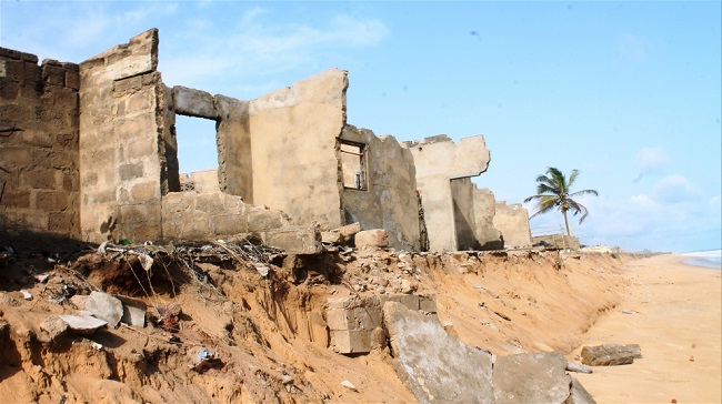 Rising sea levels are increasing eroding the coast of Togo and destroying home and businesses  © Daniel Addeh/IRIN