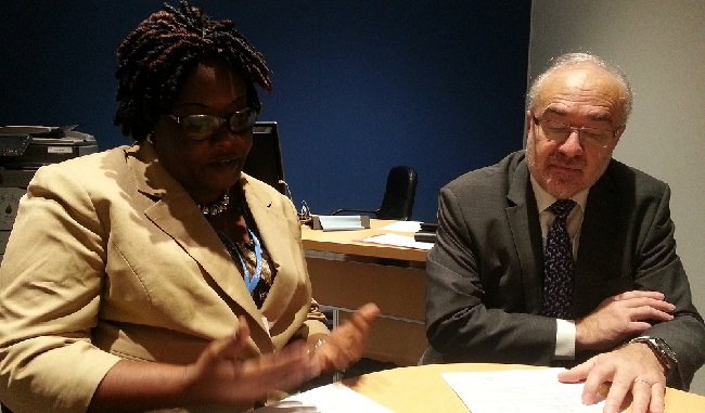 Transport Minister Angela Cassell Bush and WMO Secretary General Michel Jarraud in talks