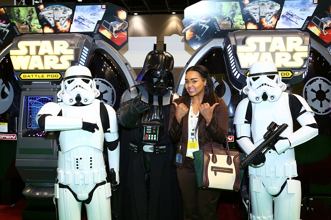 Exhibitors at the DEAL 2015 show with the Star Wars themed games