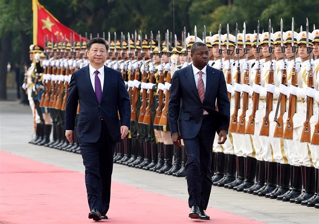 Chinese President Xi Jinping (L) welcomes  Togolese President Faure Gnassingbe before their talks in Beijing, capital of China, May 30 (Xinhua/Rao Aimin)