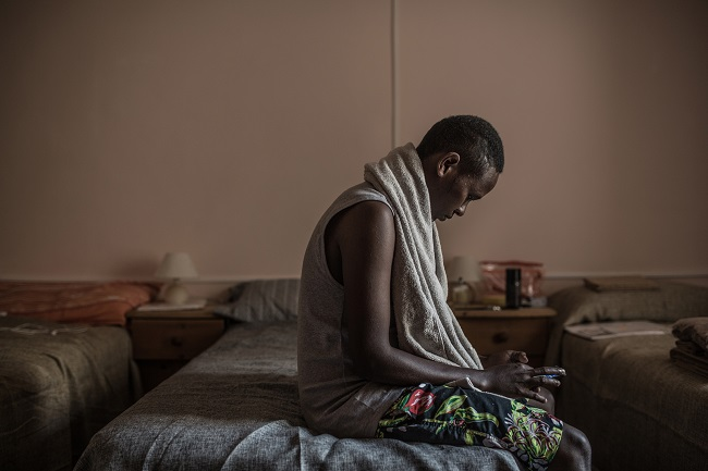 Jamal, from Somalia, arrived in Italy in May and was transferred to a reception centre where he received no information about his right to apply for asylum. Photo: Pablo Tosco/Oxfam)